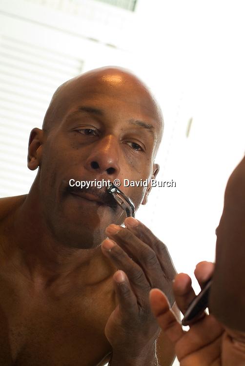 Man shaving, close-up