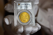 London, UK. 13 March 2015. Pictued: 1795 Eagle (Ten Dollar Gold Piece), one of the most perfectly preserved 18th Century US gold coins. Sotheby's and Stack's Bowers Galleries will present the D. Brent Pogue Collection of masterpieces of United States coinage - the most valuable coin collection in private hands - across a series of seven auctions beginning 19 May 2015 at Sotheby's New York headquarters. The overall collection, which consists of more than 650 individual coins, is expected to achieve well in excess of USD 200 million - more than any other series of rare coin auctions in history. Photo: Bettina Strenske