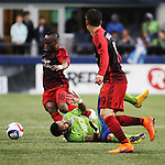 Seattle Sounders Tyrone Mears (4) is tripped up while going for the ball against vs. Portland Timbers Ishmael Yartey (18) during an MLS match on April 26, 2015 at CenturyLink Field in Seattle, Washington.  Seattle Sounders Clint Dempsey scored a goal to give the Sounders a 1-0 victory over the Timbers. Jim Bryant Photo. ©2015. All Rights Reserved.