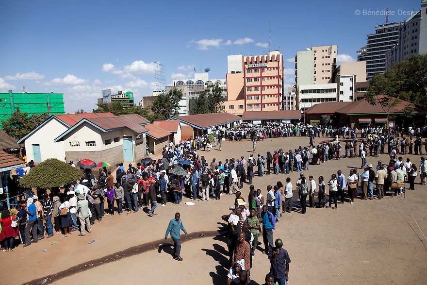 4 March 2013 - Nairobi, Kenya - Kenyans wait in line at a polling station to cast their ballots in Nairobi, Kenya. Five years after more than 1,000 people were killed in election-related violence, Kenyans began casting votes in a nationwide election seen as the country's most important, and complicated, in its 50-year history. Uhuru Kenyatta, one of two top candidates for president, faces charges at the International Criminal Court for orchestrating the 2007-08 postelection violence. Photo credit: Benedicte Desrus