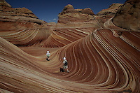 "Hikers among the rock formations at ""the Wave"" in the Coyote Buttes area of the Paria Canyon-Vermillion Cliffs Wilderness on the Utah/Arizona border. Paria Canyon-Vermillion Cliffs Wilderness, Sept. 13, 2007. The Vermillion Cliffs Wilderness, near Page, Arizona is home to canyons and amazing rock formations. The area is so sensitive that the park service only allows a total of 20 people in the park per day. Permits are given through a lottery."