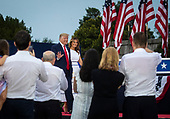 "U.S. President Donald Trump and First Lady Melania Trump arrive during the Fourth of July Celebration 'Salute to America' event in Washington, D.C., U.S., on Thursday, July 4, 2019. The White House said Trump's message won't be political -- Trump is calling the speech a ""Salute to America"" -- but it comes as the 2020 campaign is heating up. <br /> Credit: Al Drago / Pool via CNP"