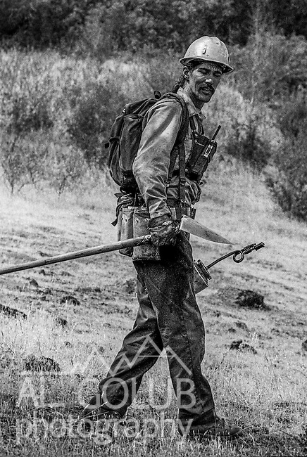 September 3, 1987 Pine Mountain Lake, California -- Stanislaus Complex Fire -- Stanislaus National Forest foreman John Buckley hikes along trail to his truck. The Stanislaus Complex Fire consumed 28 structures and 145,980 acres.  One US Forest Service firefighter, David Ross Erickson, died from a tree-felling accident.
