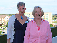 NWA Democrat-Gazette/CARIN SCHOPPMEYER Tracy Green (left) and Elaine Smith visit at the Dress for Success reception.