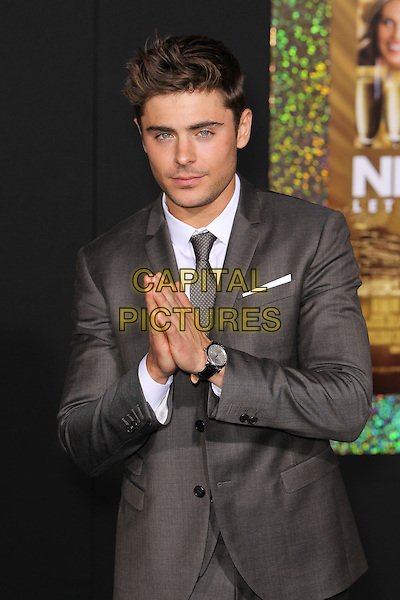 "Zac Efron.The World Premiere of ""New Year's Eve' held at The Grauman's Chinese Theatre in Hollywood, California, USA..December 5th, 2011.half length suit hands together praying  white shirt grey gray tie stubble facial hair .CAP/CEL .©CelPh/Capital Pictures."