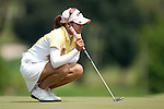 CHON BURI, THAILAND - FEBRUARY 18:  Pornanong Phatlum of Thailand lines up a putt on the 2nd green during day two of the LPGA Thailand at Siam Country Club on February 18, 2011 in Chon Buri, Thailand.  Photo by Victor Fraile / The Power of Sport Images