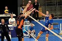 GRONINGEN - Volleybal, Abiant Lycurgus - Orion, Alfa College , Eredivisie , seizoen 2017-2018, 16-12-2017 Lycurgus speler Wytze Kooistra slaat de bal langs het blok met Orion speler Maikel van Zeist