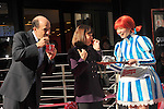 December 27, 2011, Tokyo, Japan - U.S. Ambassador to Japan John Roos takes a bite out of a Wendy's hamburger during a re-launchi celebration of its fast-food restaurant in Tokyo on Tuesday, December 27, 2011.  Mrs. Roos is in the middle. In December 2009, Wendys did not renew its franchise agreement with its former franchisee for Japan, resulting in the closure of 71 restaurants. Wendys and Higa Industries, a successful food importer and distributor based in Tokyo, signed a joint venture agreement to develop and operate Wendys restaurants in Japan. Wendys Japan plans to open 100 stores in the next five years. (Photo by Natsuki Sakai/AFLO) [3615] -mis-