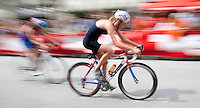 17 JUL 2011 - HAMBURG, GER - Competitors cycle through the spectator lined streets of Hamburg during the women's round of triathlon's ITU World Championship Series .(PHOTO (C) NIGEL FARROW)