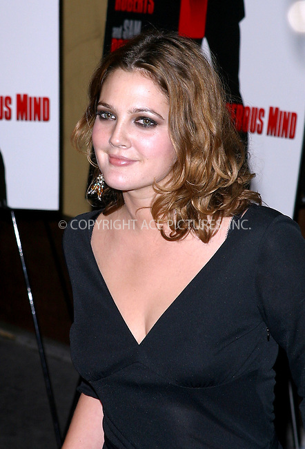 Drew Barrymore at the NY premiere of 'Confessions Of A Dangerous Mind' held at the Paris Theater. New York, December 19, 2002..Please byline: NY Photo Press. REF: M19 -- THIS REFERENCE CODE MUST APPEAR ON YOUR SALES REPORT, THANK YOU.....*PAY-PER-USE*      ....NY Photo Press:  ..phone (646) 267-6913;   ..e-mail: info@nyphotopress.com
