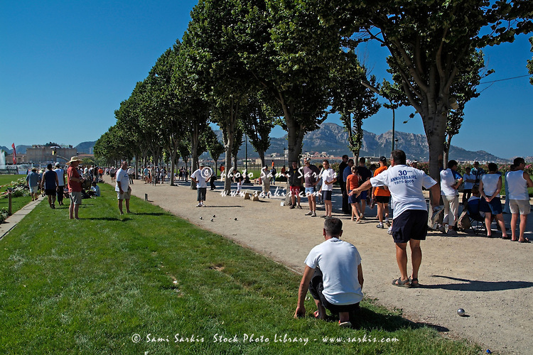 Large group of people playing French boules in Parc Borély, Marseillaise, France.