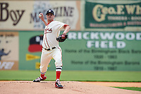 Birmingham Barons pitcher Myles Jaye (14) delivers a pitch during the 20th Annual Rickwood Classic Game against the Jacksonville Suns on May 27, 2015 at Rickwood Field in Birmingham, Alabama.  Jacksonville defeated Birmingham by the score of 8-2 at the countries oldest ballpark, Rickwood opened in 1910 and has been most notably the home of the Birmingham Barons of the Southern League and Birmingham Black Barons of the Negro League.  (Mike Janes/Four Seam Images)