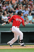 Second baseman Yoan Moncada (24) of the Greenville Drive bats in a game against the Augusta GreenJackets on Thursday, June 11, 2015, at Fluor Field at the West End in Greenville, South Carolina. The Cuban-born 19-year-old Red Sox signee has been ranked the No. 1 international prospect in baseball by Baseball America. Greenville won, 10-1. (Tom Priddy/Four Seam Images)