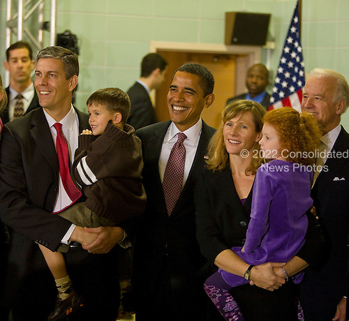Chicago, Il - December 16, 2008 -- United States President-elect  Barack Obama, center, and Vice President-elect Joseph Biden, right, pose for a photo with  Chicago School Chief Arne Duncan, left, and his family after announcing Duncan's nomination  to be Secretary of Education..Credit: Ralf-Finn Hestoft - Pool via CNP