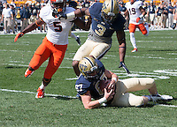 Pitt long snapper David Murphy (67) downs a punt. The Pitt Panthers defeated the Virginia Cavaliers 14-3 at Heinz Field, Pittsburgh, PA on Saturday, September 28, 2013.