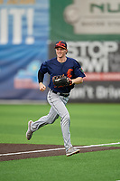 Connecticut Tigers center fielder Kingston Liniak (17) jogs to the dugout during a NY-Penn League game against the Auburn Doubledays on July 12, 2019 at Falcon Park in Auburn, New York.  Auburn defeated Connecticut 7-5.  (Mike Janes/Four Seam Images)