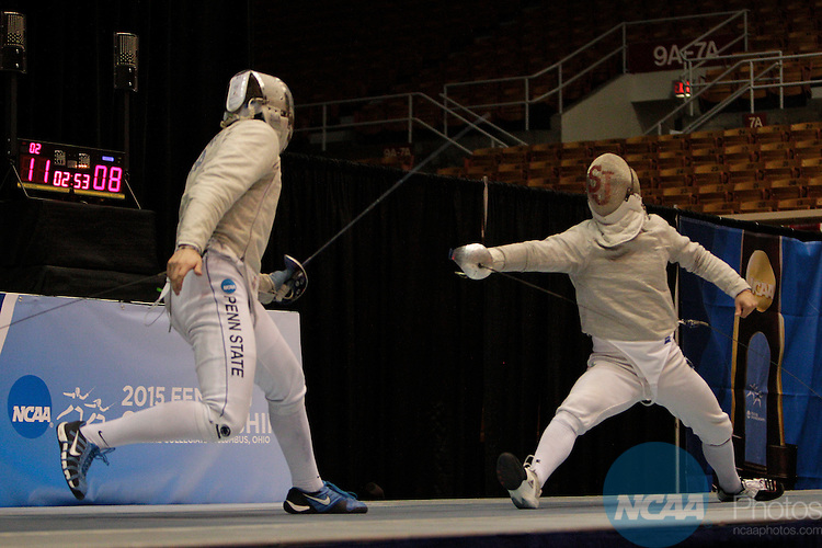 20 MAR 2015:  Andrew Mackiewicz, left, of Penn State, fences against Ferenc Valkai, of St. John's, in the sabre event finals during the Division I Men's Fencing Championship held at St. John Arena on the Ohio State University campus in Columbus, OH. Mackiewicz won the championship by a score of 15-10. Jay LaPrete/NCAA Photos