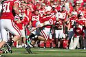 30 October 2010: Nebraska quarterback Taylor Martinez (3) breaks free from Missouri at Memorial Stadium in Lincoln, Nebraska. Nebraska defeated Missouri 31 to 17.