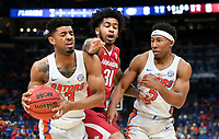 NWA Democrat-Gazette/CHARLIE KAIJO Arkansas Razorbacks guard Anton Beard (31) reaches for a pass intended for Florida Gators guard Jalen Hudson (3) as guard KeVaughn Allen (5) covers during the Southeastern Conference Men's Basketball Tournament quarterfinals, Friday, March 9, 2018 at Scottrade Center in St. Louis, Mo.