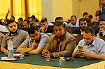 """Palestinian Activists tweet with the hashtag """"Resistance is not terrorism"""" during a press conference in Gaza city on July 24, 2017. Photo by Mohammed Asad"""