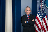 Director of the National Institute of Allergy and Infectious Diseases at the National Institutes of Health Dr. Anthony Fauci listens as President Donald Trump delivers remarks on the COVID-19 (Coronavirus) pandemic alongside members of the Coronavirus Task Force in the Brady Press Briefing Room at the White House in Washington, DC, March 25, 2020, in Washington, D.C. <br /> Credit: Sarah Silbiger / Pool via CNP/AdMedia