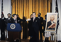 Washington DC., USA, February 2, 1984<br /> President Ronald Reagan unveils postage stamp at a White House Ceremony marking the observance of National Afro-American (Black) History Month Credit: Mark Reinstein/MediaPunch