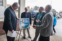 NWA Democrat-Gazette/ANTHONY REYES &bull; @NWATONYR<br /> Springdale mayor Doug Sprouse (from left) Fayetteville mayor Lionel Jordan, Lowell mayor Eldon Long and John McLarty, with the Northwest Arkansas Regional Planning Commission, take a look at a sign Monday, Nov. 16, 2015 at the Shiloh Square in Springdale. The Northwest Arkansas Regional Planning Commission announced that Benton and Washington counties are recognized as a Bronze Bicycle Friendly Community by the League of American Bicyclists. The signs will got up in each of the cities to commemorate the award. The award was given for the commitment of the two counties to invest in the promotion, education and infrastructure for bicyclists.