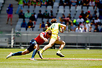 Marcos Poggi doing a great tackle to Ben O'Donnell, Day 1 at Cape Town Stadium duirng the HSBC World Rugby Sevens Series 2017/2018, Cape Town 7s 2017- Photo Martin Seras Lima