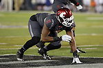 Ivan McLennan prepares for the snap during the Washington State Cougars non-conference road opener against the Nevada Wolfpack at Mackay Stadium in Reno, Nevada, on September 5, 2014.