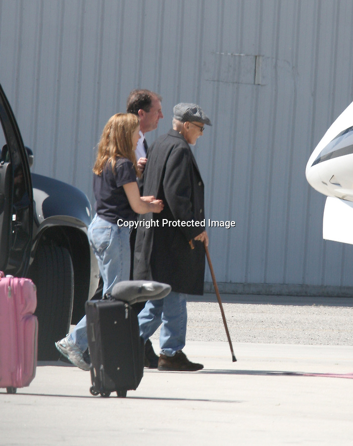 April 9th 2010  Exclusive...American legend & star of the classic film Easy Rider Dennis Hopper walks onto a private jet with his family in Los Angeles California.  Neighbors of Dennis told the photographer he was leaving on a permanent vacation with his family where he plans on dieing in peace. These might be the last pictures of Mr. Hopper alive. Although Dennis is battling cancer he seemed to be in a very good mood as he stepped out of his limo using a wood cane. He did need a little help up the stairs but managed to make it on the plane okay. ...AbilityFilms@yahoo.com.805-427-3519.www.AbilityFilms.com.