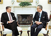 United States President Ronald Reagan meets with Ambassador Richard B. Stone, Special Representative of the President to Central America, in the Oval Office of the White House in Washington, DC on July 7, 1983.<br /> Mandatory Credit: Michael Evans / White House via CNP