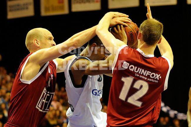 GRONINGEN - Basketbal, Martiniplaza,  Gasterra Flames - Eiffeltowers,  Dutsch Basketball League, halve finale  play-offs 5 , seizoen 2011-2012, 13-05-2012 Peter van Paassen (l) en Kees Akerboom (r0 in duel met Jason Dourisseau (m)..