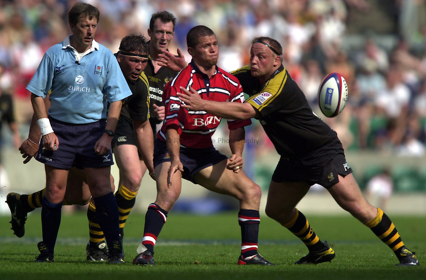 Photo: Richard Lane..Gloucester v London Wasps. Zurich Premiership Final 2003 at Twickenham. 31/05/2003..Henry Paul gets the ball away as Will Green tackled under the watchful eye of referee, Tony Spreadbury.