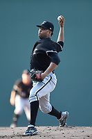 Pitcher Kelvis Valerio (22) of the Kannapolis Intimidators delivers a pitch in a game against the Greenville Drive on Friday, July 14, 2017, at Fluor Field at the West End in Greenville, South Carolina. Greenville won, 2-0. (Tom Priddy/Four Seam Images)