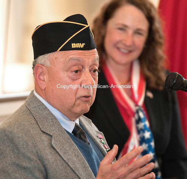 WATERBURY,  CT,  CT-040815JS03- Vietnam Veteran Vic Allessio of Waterbury, gives hie remarks after receiving his medals earned for his service in the U.S. Army, during a ceremony Wednesday at Waterbury City Hall's Veterans Memorial Hall as Congresswoman Elizabeth Esty, right, who presented the medals, looks on.  Allessio received his Bronze Star, an Army Commendation Medal, a National Defense Medal, a Vietnam Service Medal with a Silver Star, a Republic of Vietnam Campaign Ribbon, an Expert Badge with Auto Rifle and a Marksman Badge for Rifle. <br />  Jim Shannon Republican-American