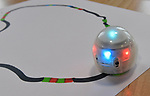 This small Ozobot follows the special color-coded path drawn on paper, and spins and flashes it's lights based on the color combinations. The Magic House had two fourth-grade classes from the New City School visit their new permanent satellite location at 5127 Delmar Boulevard in St. Louis, MO on Wednesday May 23, 2019.<br /> Photo by Tim Vizer