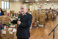 STAFF PHOTO ANTHONY REYES &bull; @NWATONYR<br /> Major N.J. Pope, area commander of Northwest Arkansas for the Salvation Army, gives a few remarks Tuesday, Dec. 16, 2014 at a toy storage facility in Springdale. Gifts from the Salvation Army's Angel Tree program are organized and stored at the facility. The organization will be handing the gifts out over the next few days along with food items donated by local organizations including a turkey and eggs.