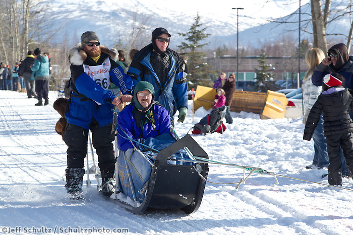 James Volek and team run past spectators on the bike/ski trail during the Anchorage ceremonial start during the 2013 Iditarod race.    Photo by Britt Coon/IditarodPhotos.com