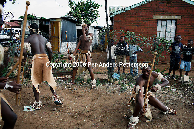 SOWETO, SOUTH AFRICA OCTOBER 28: A traditional Zulu dance group warms up before a performance at a wedding reception October 28, 2006 in Diepkloof section of Soweto, Johannesburg, South Africa. Many people fight to keep their old traditions as they are facing difficulties to keep them, because of the life is becoming more westernized. Soweto is South Africa&rsquo;s largest township and it was founded about one hundred years to make housing available for black people south west of downtown Johannesburg. The estimated population is between 2-3 million. Many key events during the Apartheid struggle unfolded here, and the most known is the student uprisings in June 1976, where thousands of students took to the streets to protest after being forced to study the Afrikaans language at school. Soweto today is a mix of old housing and newly constructed townhouses. A new hungry black middle-class is growing steadily. Many residents work in Johannesburg but the last years many shopping malls have been built, and people are starting to spend their money in Soweto.  <br /> (Photo by Per-Anders Pettersson)