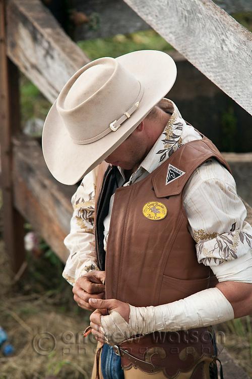 A cowboy getting ready for bull ride competition at Mt Garnet Rodeo.  Mt Garnet, Queensland, Australia