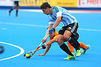 Argentina's Ignacio Ortiz wins the ball from a Malaysian defender during the Hockey World League Semi-Final match between Argentina and Malaysia at the Olympic Park, London, England on 24 June 2017. Photo by Steve McCarthy.