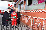 Mags O'Shea, Bridann Carey and Monica O'Sullivan with Santa Claus at the Spar shop in Fossa which has turned into a gingerbread house to raise funds for St Mary of the Angels