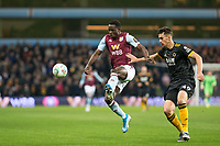 30th October 2019; Villa Park, Birmingham, Midlands, England; English Football League Cup, Carabao Cup, Aston Villa versus Wolverhampton Wanderers; Keinan Davis of Aston Villa jumps in the air to volley the ball as Maximilian Kilman of Wolverhampton Wanderers comes in to tackle - Strictly Editorial Use Only. No use with unauthorized audio, video, data, fixture lists, club/league logos or 'live' services. Online in-match use limited to 120 images, no video emulation. No use in betting, games or single club/league/player publications