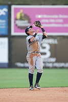 Pulaski Yankees shortstop Wilkerman Garcia (28) catches a pop fly during the game against the Danville Braves at American Legion Post 325 Field on July 31, 2016 in Danville, Virginia.  The Yankees defeated the Braves 8-3.  (Brian Westerholt/Four Seam Images)