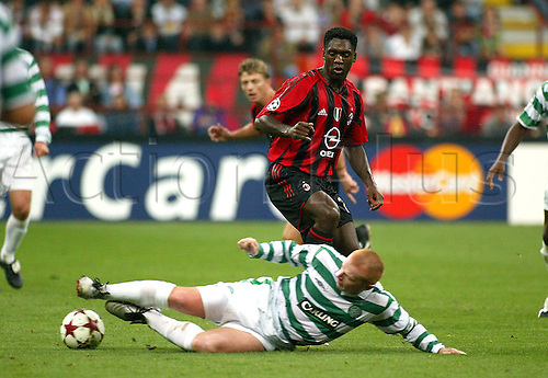 29.09.2004 Clarence Seedorf (Milan) receives a sliding tackle from Neil Lennon (Celtic)Champions League 2004/2005, Celtic Glasgow versus AC Miland