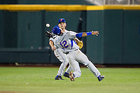 Florida Gators shortstop Richie Martin (12) makes an over the shoulder catch during the NCAA College baseball World Series against the Virginia Cavaliers on June 15, 2015 at TD Ameritrade Park in Omaha, Nebraska. Virginia defeated Florida 1-0. (Andrew Woolley/Four Seam Images)