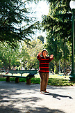 USA, California, San Francisco, a woman performs Tai Chi, Washington Square Park