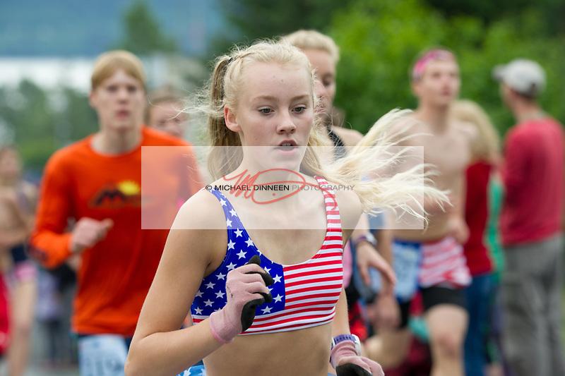 Chugiak's Adrianna Proffitt races toward the mountain..  Photo for the Star by Michael Dinneen