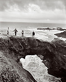 USA, California, family enjoying on rocks by the sea, Mendocino (B&W)