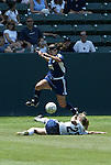 27 June 2004: Shannon MacMillan (8) vaults over a sliding Leslie Gaston (29). The San Diego Spirit defeated the Carolina Courage 2-1 at the Home Depot Center in Carson, CA in Womens United Soccer Association soccer game featuring guest players from other teams.